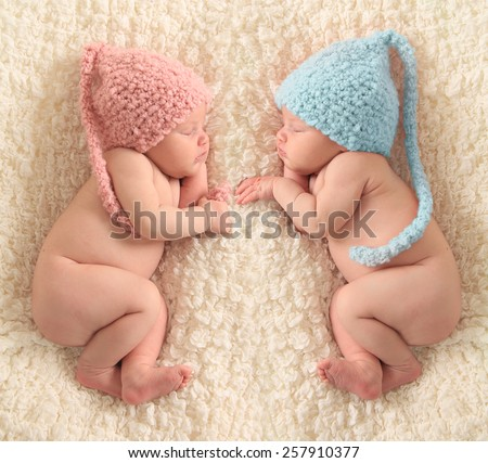 Newborn twin babies, boy and girl - stock photo