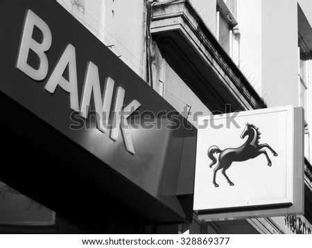 Newbury, Northbrook Street, Berkshire, England - October 10, 2015: Lloyds bank sign over local branch, British retail and commercial bank, origins of Lloyds Bank date from 1765 - stock photo
