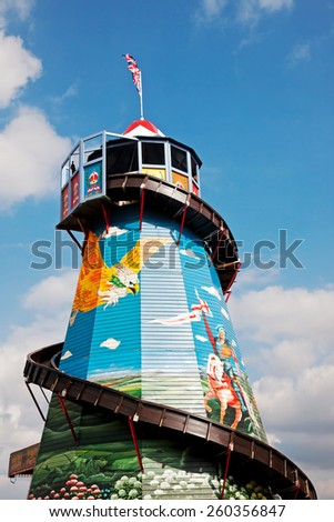 NEWBURY, UK - SEPTEMBER 21: A helter skelter ride stands proudly at the centre of the fun fair area at the Berks showground for the public to take pleasure rides on, on September 21, 2014 in Newbury - stock photo