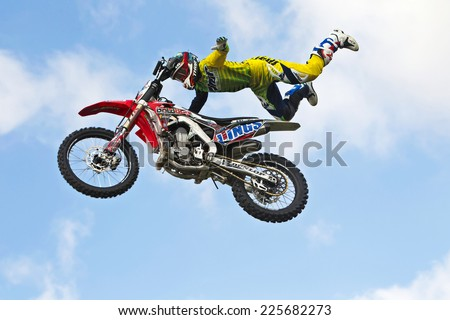 NEWBURY, UK - SEPTEMBER 21: Daniel Whitby of the Boldog FMX team demonstrates one of his stunts, the superman, to the public at the Berks show in the main arena on September 21, 2014 in Newbury - stock photo