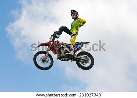 NEWBURY, UK - SEPTEMBER 21: Daniel Whitby of the Boldog FMX team displays some of his freestyling act to the public at the Berks County show on September 21, 2014 in Newbury - stock photo