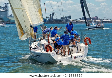 NEWCASTLE,AUSTRALIA - JANUARY 24,2015: Members of a local sailing club race their boats on the harbour. Newcastle is the 2nd city of New South Wales, after Sydney. - stock photo