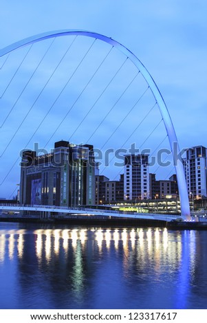 "NEWCASTLE, UK - DECEMBER 29: Newcastle's Millennium bridge, designed by the architectural firm Wilkinson Eyre, on the River Tyne is to lose it's painful ""harbourmaster"" piles in 2012. 29 December 2012 - stock photo"