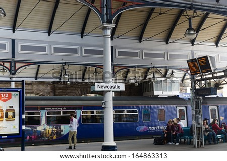 NEWCASTLE, UK - MAY 05: Central Railway Station of Newcastle on May 05 2013. Opened in 1850 by Queen Victoria, it was the first covered railway station in the world and was much copied across the UK. - stock photo