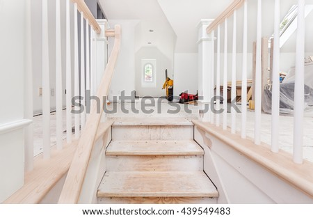 Newel posts, handrails and balusters installed and sanded smooth - stock photo