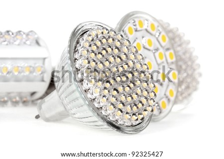 Newest LED light bulb technology is 90% more efficient than incandescent or halogen bulbs - stock photo