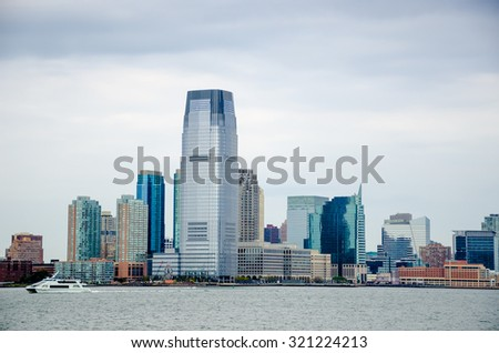 Newjersey Skyline over Hudson River on cloudy day. NewYork City, USA - stock photo