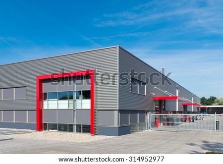 newly build modern red warehouse with offices - stock photo