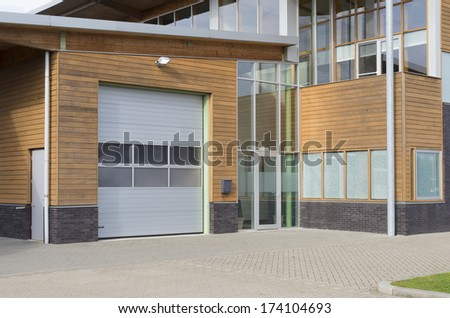 newly build office building with integrated warehouse - stock photo