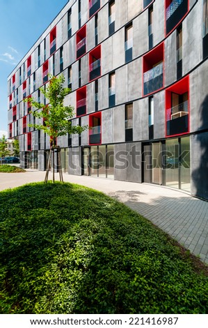 Newly built block of flats in modern design with red color - stock photo