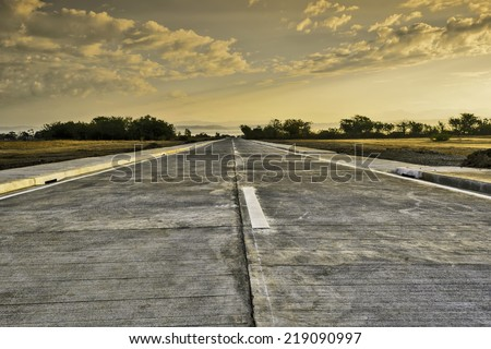 Newly built concrete road leading to a resort, Philippines - stock photo