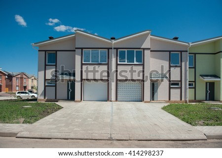 Newly-built townhouses - stock photo