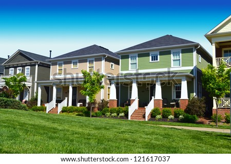 Newly Constructed Neighborhood of Cape Cod Suburban American Homes - stock photo
