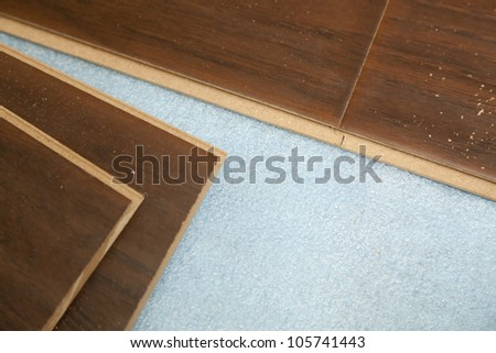 Newly Installed Brown Laminate Flooring Abstract. - stock photo