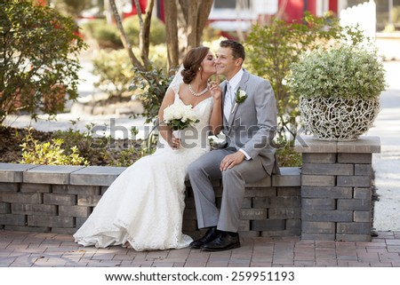 newly married young couple having private moment in the garden - stock photo