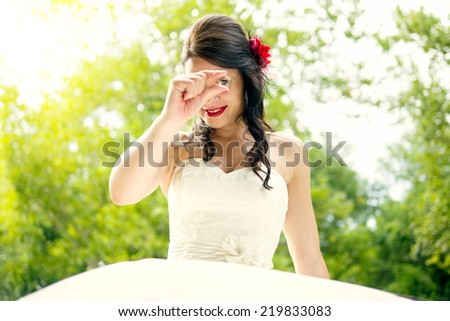 Newlywed bride in park  - stock photo