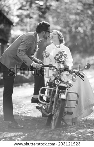 Newlywed caucasian couple together. Wedding day in black and white. - stock photo