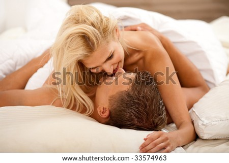 Newlywed couple during sex act - stock photo