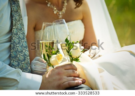 Newlyweds clinking glasses and enjoying romantic moment together at - stock photo