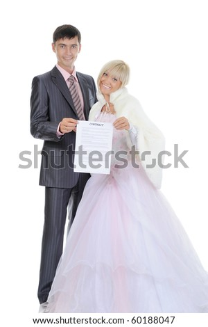 newlyweds kept a marriage contract. Isolated on white background - stock photo