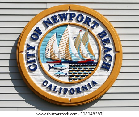 NEWPORT BEACH, CA-AUGUST, 2015:  Newport Beach surrounds Newport Bay where more than 9,000 boats of all types are docked within the 21-square-mile harbor area.  - stock photo
