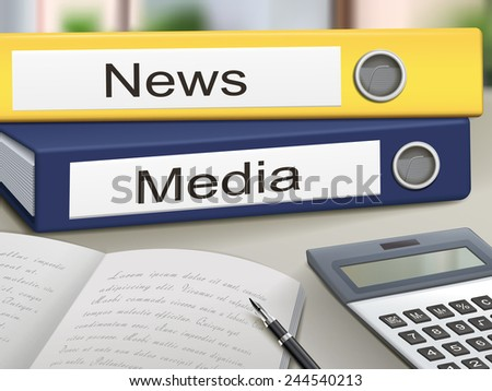 news and media binders isolated on the office table - stock photo