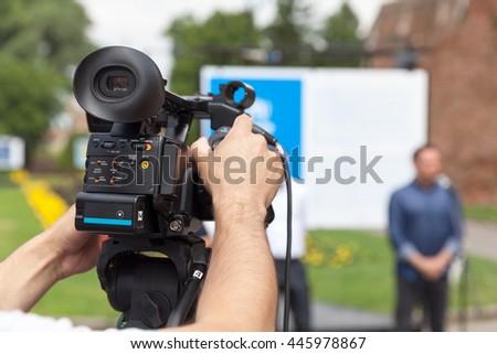 News conference. Video camera. Spokesperson. - stock photo