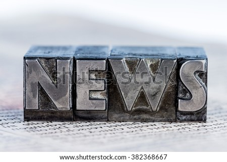 news in lead letters - stock photo