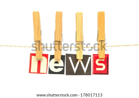 News in wooden clothes pegs - stock photo