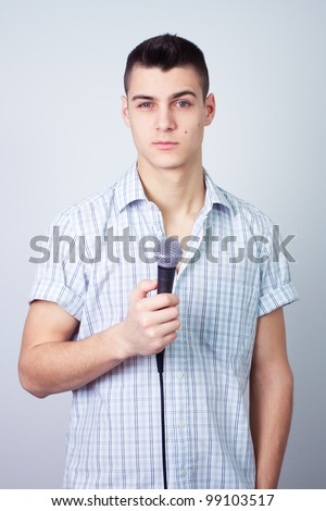 news reporter journalist interviews a person holding up the microphone - stock photo