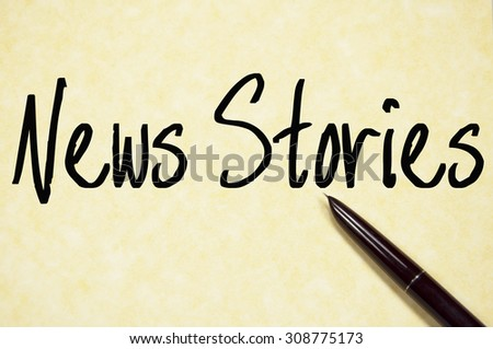 news stories text write on paper  - stock photo