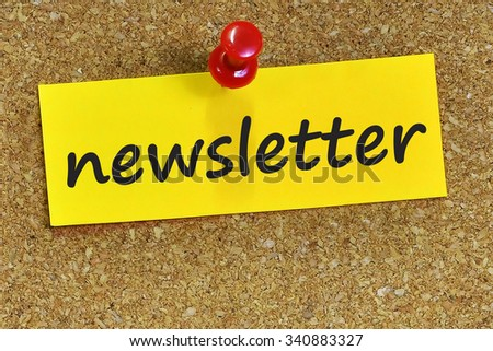 newsletter word on yellow notepaper with cork background. - stock photo