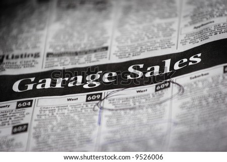 Newspaper Ad for Garage Sales (very shallow DOF) - stock photo