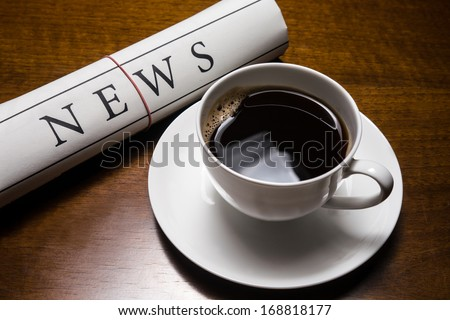 newspaper and cup of coffee on table - stock photo