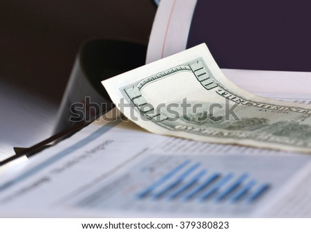 Newspaper and dollar bill - stock photo