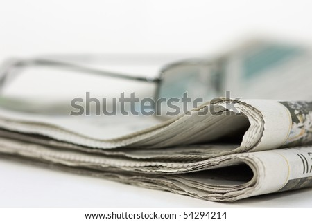 Newspaper and Spectacles - stock photo
