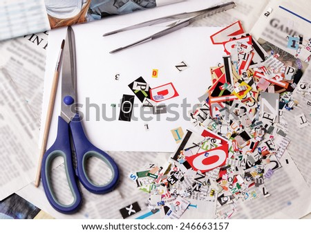 Newspaper clippings alphabet with letters, numbers and symbols with scissors - stock photo