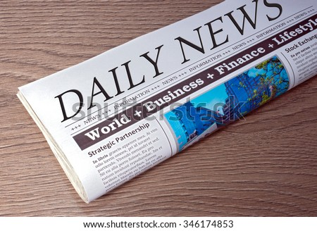 Newspaper - Daily News on wooden background - stock photo
