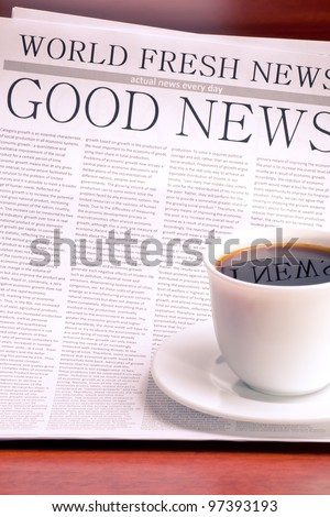 Newspaper GOOD NEWS and cup of coffee - stock photo