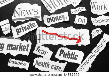newspaper headlines showing bad news, red down arrow - stock photo