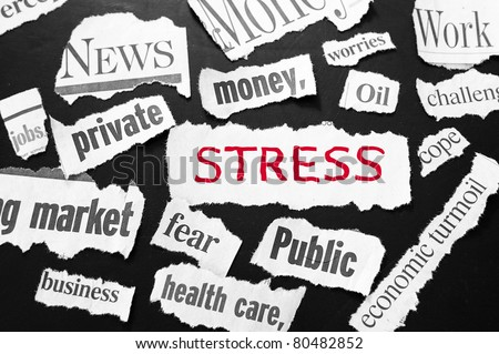 newspaper headlines showing bad news, stress in red - stock photo