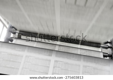Newspaper offset print production line wide shot - stock photo