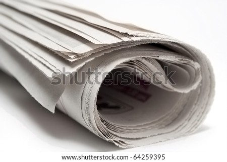 Newspaper on white background, close-up - stock photo