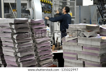 newspaper production and printing process - stock photo