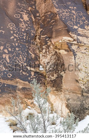 Newspaper Rock petroglyphs in winter, at the Newspaper Rock State Historic Monument in Utah. - stock photo