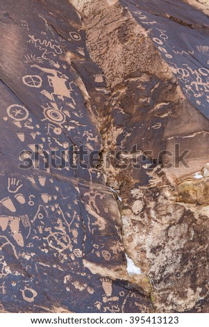 Newspaper Rock petroglyphs made by various native peoples over the last 2000 years, at the Newspaper Rock State Historic Monument in Utah. - stock photo