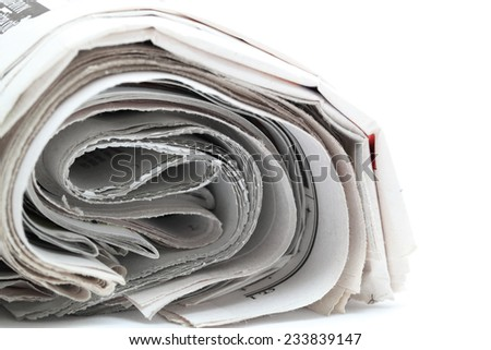 newspaper roll isolated on white background - stock photo
