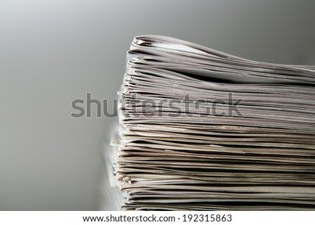 Newspaper stack on white background  - stock photo