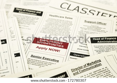 newspaper with advertisements and classifieds ads for vacancy, employment opportunities - stock photo