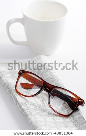 Newspaper with cup of coffee - stock photo